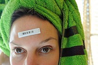 Woman with bar code on forehead