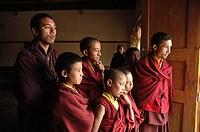 Monks looking out a door Lama Yuru, Ladakh, India