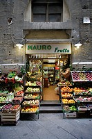 Traditional grocery store selling fruit and vegetable seen from front in a side street of the heart of Florence (Firenze), Tuscany, Italy, Southern Eu...
