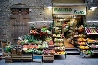 Traditional grocery store selling fruit and vegetable - and a pushcart besides - in a side street of the heart of Florence (Firenze), Tuscany, Italy, ...