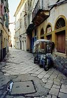 Lane and motorcycle. Corfu. Greece