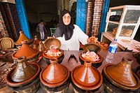 Woman cooking in tajine pots, Guezoula near Safi, Morocco.