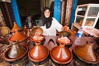 Woman cooking in tajine pots, Guezoula near Safi, Morocco.