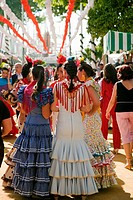 Women wearing a flamenco style dress in the Seville Spring Fair, Seville, Andalusia, Spain
