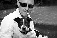 Portrait of young man with Jack Russell pet dog