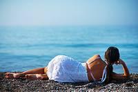 A beautiful woman relaxing on a beach