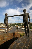 hands across the divide sculpture by maurice harron in derry city county londonderry northern ireland uk the bronze statues stand on separate columns ...