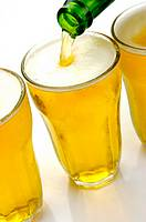 Glasses of beer isolated against a white background