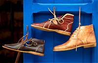 Morocco, Asilah, shoes hanging on blue door