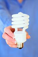 Hands holding energy efficent lightbulb