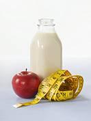 Milk, apple and tape measure