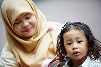 a muslim mother with her young child  kuala lumpur  malaysia  asia
