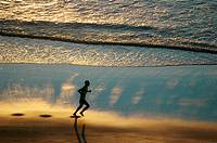 Jericoacoara (Ceara, Brazil): a man jogging at sunset along the beach