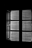 Window with the blinds down  View from inside  Black and white  Conceptual