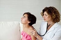 Doctor examining teenager