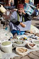 Morocco Marrakesh Place Rahba Kedima (Place des Epices) Street vendor selling herbs