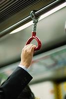 A hand of a businessman inside MTR in Hong Kong, HKSAR