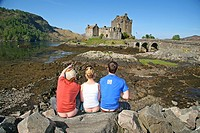 The famous Eilean Donan Castle. Beautiful day with beautiful people showing some beautiful butt crack. Scotland, UK