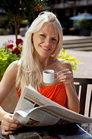one young woman drinking coffe outdoor