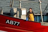 Fisherman on a boat returning to harbour, Aberystwyth