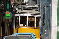The popular tram 28 through the winding and narrow streets of Alfama. Lisbon, Portugal
