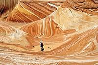 Hiker in The Wave, Paria Canyon-Vermillion Cliffs Wilderness, Arizona