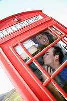 How many people can cram into a UK phone box: twelve were managed to squeeze in here