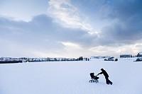 A woman walking with a pram in the snow  Hafnarfjordur, Iceland
