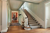 Foyer in traditional home with green wals