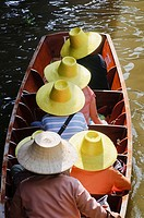 Tourists at the Floating Market Damnoen ,Saduak Thailand