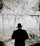 An religious orthodox Jewish man at the Wailing Western Wall in Jerusalem in Israel in the Middle East