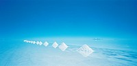 The salt pyramids on the salt flats of the Salar de Uyuni in Bolivia in Latin South America