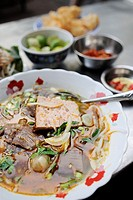 Traditional noodle soup with a slice of beef served as delicious street food (´pho bo´), Ho Chi Minh City, Vietnam