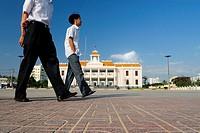 Walking past ´Nha Van Hoa´, Nha Trang´s Vietnamese Cultural House located at the beach promenade Tran Phu,  Nha Trang, Vietnam
