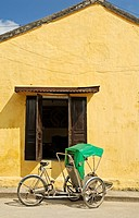 Asia, Vietnam, Hoi An  Hoi An old quarter  Cyclo waiting for customers  The historic buildings, attractive tube houses, and decorated community halls ...