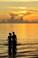 Orange sunset and couple, Caribbean, Isla de la Juventud, Cuba