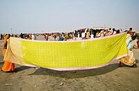 Drying up the sari on the beach of Gangasagar Island.