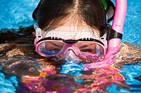 Close-up of young girl wearing dive mask while snorkeling