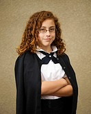 School age mixed race Mexican & caucasian girl with glasses in school uniform
