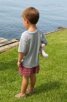 Young boy gazing out to the water