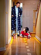 Boy caught after painting stripes on floor to race car in hallway