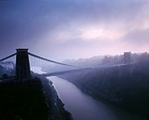 Clifton Suspension Bridge over the River Avon in the Avon Gorge in winter fog just after sunset  Bristol, England, United Kingdom