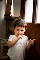 Young boy waiting by the door at home, crying  Iceland