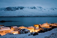 View over Vopnafjordur at dusk during winter, East Iceland  Vopnafjordur hopes to service the oil industry if oil is found underwater in the Dreki are...