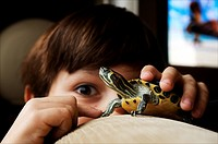 Seven years old boy playing with a domestic turtle at home