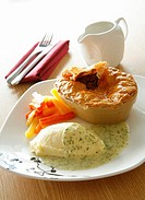 Pie, mash and vegtables with a parsley sauce