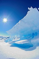 Canadian High Arctic, Lancaster Sound, Nunavut Canada May 2004 Arctic landscape with midnight sun in sky, blue ice