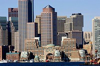 Skyline financial district Boston Massachusetts USA New England modern buildings contrast architecture city business Rowes Wharf ferry harbor boats wa...