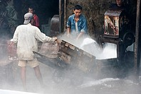 Workers in the fish Market, crashing ice.