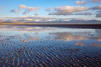 Newborough, Anglesey, North Wales, UK, Europe  Tidal pool reflecting clouds on Traeth Llanddwyn conservation beach in National Nature Reserve in early...